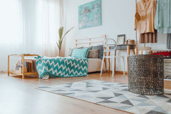 Small table on the rug. Small creative table with candles standing on the rug with patterns stock images