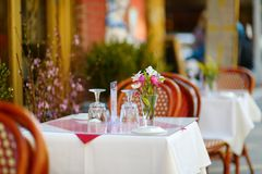 Free Small Table Set For Dinner In Outdoor Cafe In Little Italy Neighborhood In Downtown Manhattan, New York City Stock Photo - 130629170