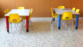 Small tables with chairs in the classroom Royalty Free Stock Photo