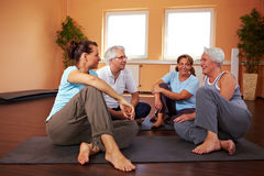 Small talk in gym. Fitness group having small talk in a gym Royalty Free Stock Photo