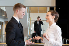 Small talk before work. In business centre Stock Photo