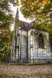 Small tall chapel in the woods Stock Image