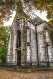 Small tall chapel in the woods Stock Photos