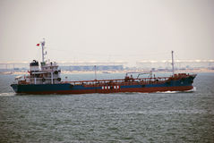 Small tanker in Singapore anchorage. Royalty Free Stock Images