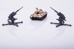 Small tanks, toy tanks, tanks on the wooden floors. Tanks, macro, macro toy tanks, taken Isolated on a white background Royalty Free Stock Photography