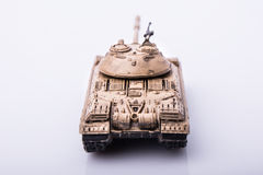 Small tanks, toy tanks, tanks on the wooden floors. Tanks, macro, macro toy tanks, taken Isolated on a white background Stock Photo