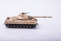 Small tanks, toy tanks, tanks on the wooden floors. Tanks, macro, macro toy tanks, taken  on a white background Stock Image