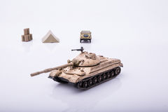 Small tanks, toy tanks, tanks on the wooden floors. Tanks, macro, macro toy tanks, taken on a white background Royalty Free Stock Photography