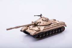 Small tanks, toy tanks, tanks on the wooden floors. Tanks, macro, macro toy tanks, taken on a white background Royalty Free Stock Photo