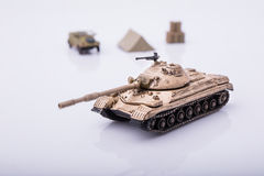 Small tanks, toy tanks, tanks on the wooden floors. Tanks, macro, macro toy tanks, taken on a white background Royalty Free Stock Image