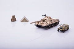 Small tanks, toy tanks, tanks on the wooden floors. Tanks, macro, macro toy tanks, taken  on a white background Stock Photography
