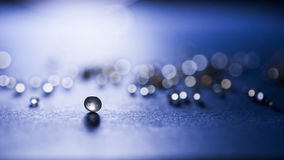 Small, tansparent balls abstract with bokeh and blue Royalty Free Stock Photography