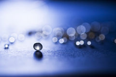 Small, tansparent balls abstract with bokeh and blue Stock Photography