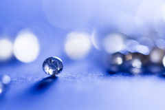 Small, tansparent balls abstract with bokeh and blue Royalty Free Stock Photos