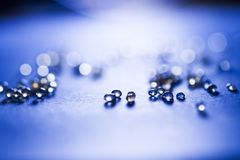 Small, tansparent balls abstract with bokeh and blue Royalty Free Stock Images
