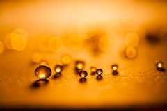 Small, tansparent balls abstract with bokeh and orange Royalty Free Stock Photo