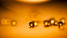 Small, tansparent balls abstract with bokeh and orange Royalty Free Stock Photos