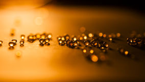 Small, tansparent balls abstract with bokeh and orange Royalty Free Stock Image