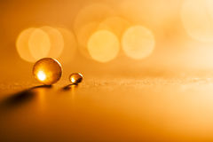 Small, tansparent balls abstract with bokeh and orange Stock Photos