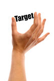 Small target. Vertical shot of a hand holding the word Target between two fingers, isolated on white Royalty Free Stock Image