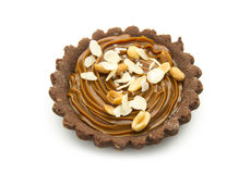 Small tart. Small chocolate tart with caramel on white background stock photos