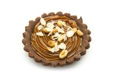 Small tart. Small chocolate tart with caramel  on white background Stock Photos
