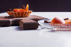 Small tart with persimmon Stock Image