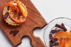 Small tart with persimmon Royalty Free Stock Photography