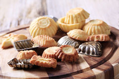 Small tart shells and baking pans Royalty Free Stock Image