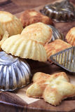 Small tart shells and baking pans Stock Photo