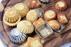 Small tart shells and baking pans Stock Photography