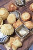 Small tart shells and baking pans Royalty Free Stock Photos