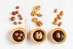 Small Tarts with different nuts and chocolate, top view stock photo