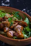 Chicken bites in a rustic bowl royalty free stock images
