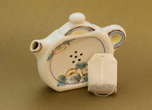 Small tea bag with teapot shaped teabag holder Stock Image