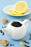 Small tea pot with leaves of black tea Royalty Free Stock Photography