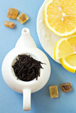 Small tea pot with leaves of black tea Royalty Free Stock Photos