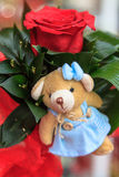 Small teddy bear. In a bouquet of roses Stock Photos