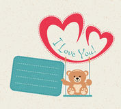 Small teddy bear sitting on a swing of two hearts and keeps in the paw of greeting card Stock Images