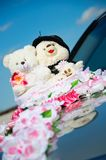 Small teddy plush on wedding Royalty Free Stock Image