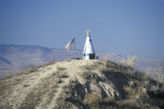 Small teepee and American flag. On hill in Northwest MT royalty free stock photography