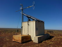 Small telecommunications hut with microwave dishes stock photography