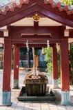 Temizuya water ablution pavilion at Naminoue shrine, Naha, Okina. Small Temizuya Japanese water ablution pavilion at Naminoue shrine, Naha, Okinawa Stock Photo