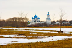 Small temple on the background of a winter landscape in Russia. Royalty Free Stock Photos