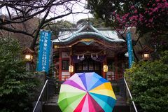 Small temple and colourful umbrella, Shiba-park, Tokyo. The photo was made during the trip in Japan stock photography