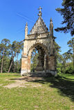 Small temple of the Saint Hubert by the trees Royalty Free Stock Photo