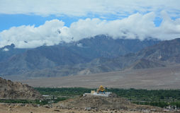 Small temple on top of hill with mountains in Ladakh, India Royalty Free Stock Images