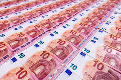 Small ten euro banknotes background Stock Image