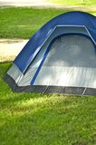 Small Tent. Small Iglo Style Tent on the Campsite. Vertical Outdoor and Lifestyle Photography Royalty Free Stock Photo