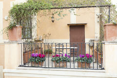 Small terrace decorated with flowers in Rome, Italy Royalty Free Stock Images